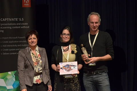 Vicky Vermeulen and Swen Vincke receiving their award from Marina De Moerlooze