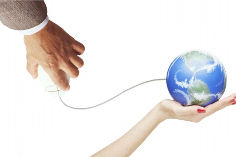 male hand with mouse connects to globe in female hand